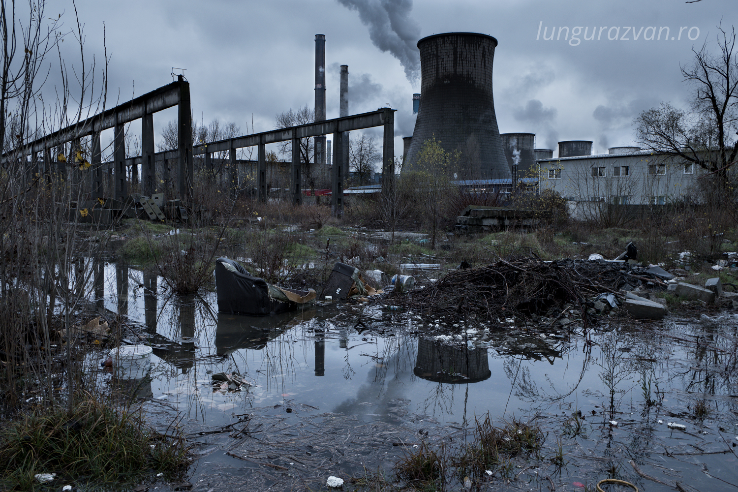 Pollution, Man Made Disaster. A desolate landscape filled with garbage and toxic industrial fumes.