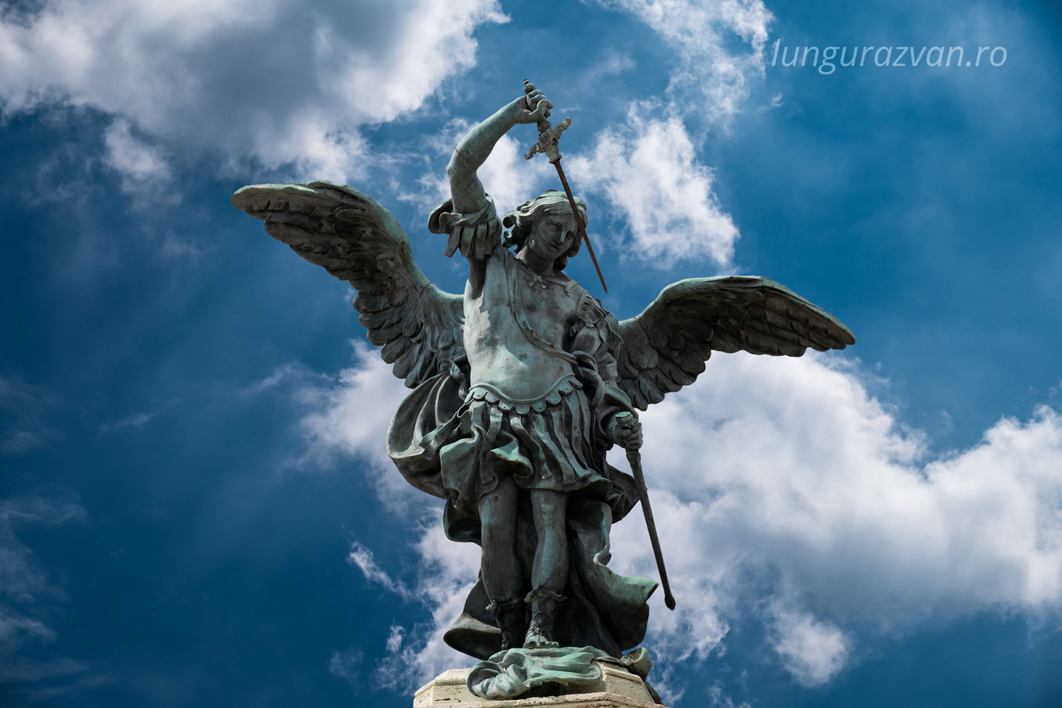 Statue of Archangel Michael on top of castle  Sant' Angelo