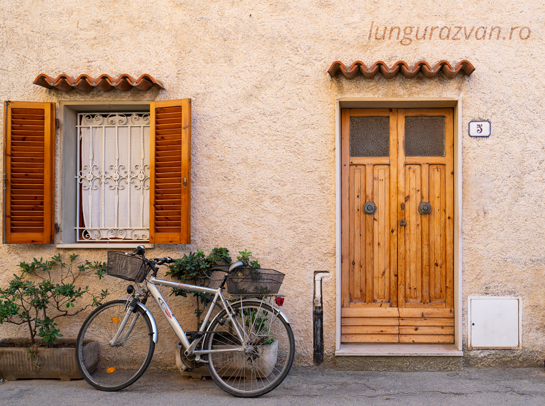 Home Sweet Home, Follonica. A bicycle leaning on a wall under a window.